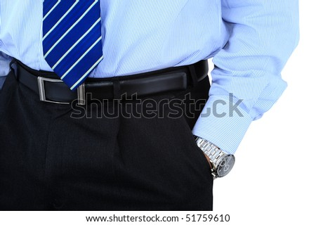 Businessman's hand in the pocket with shiny wristwatch - stock photo