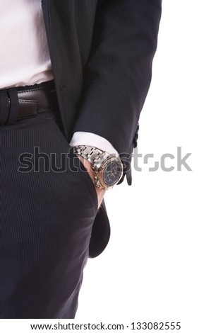 Businessman's hand in the pocket with wristwatch. - stock photo