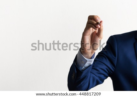 Businessman's hand on writing and drawing stance (dark tone) - stock photo