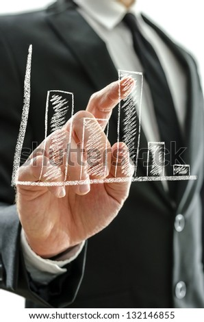 Businessman's hand pointing at graph - stock photo