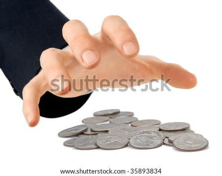 Businessman's hand reaching for a heap of quarters, isolated on white - stock photo