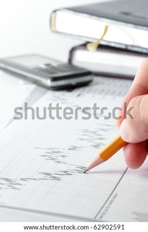 Businessman's hand showing diagram - stock photo