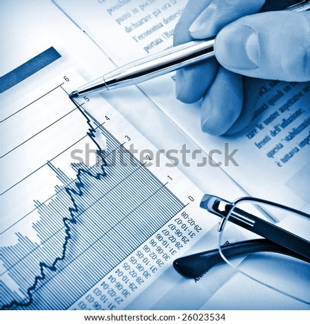 Businessman's hand showing diagram on financial report with pen. Business background 04 - stock photo