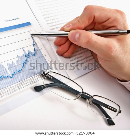 Businessman's hand showing diagram on financial report with pen. Business background 11 - stock photo