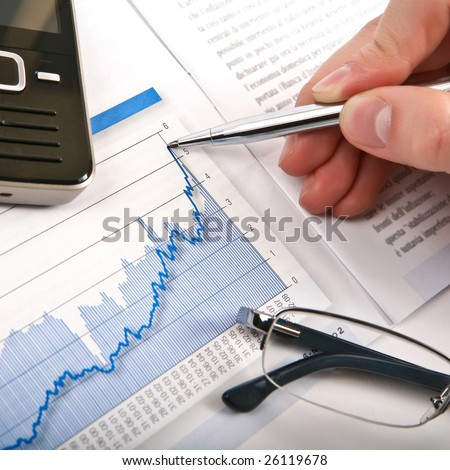 Businessman's hand showing diagram on financial report with pen. Business background 06 blue - stock photo