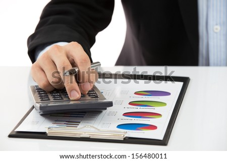Businessman's hand showing financial report - stock photo
