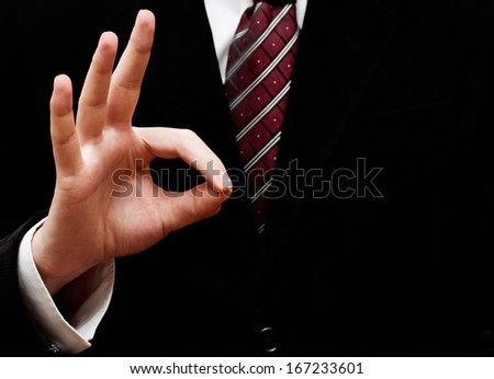 Businessman's hand showing ok sign - stock photo