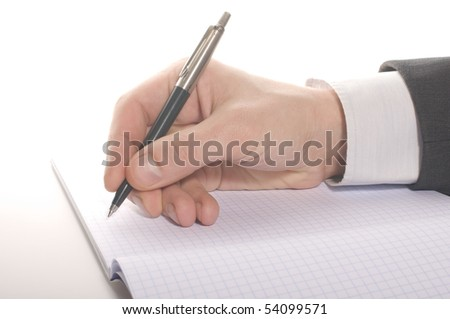 businessman's hand signing an note