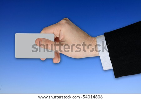 Businessman's Hand with blank credit Card on blue Sky