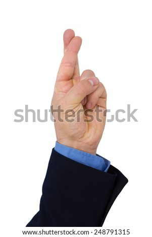 Businessman's Hand With Finger Crossed Against White Background - stock photo