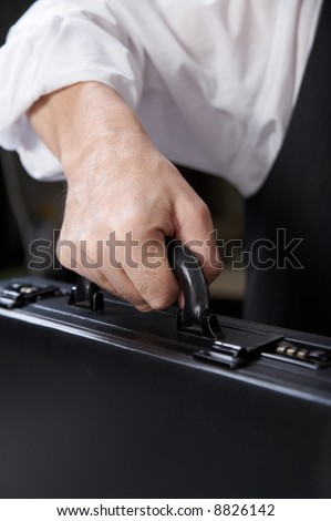 businessman's hand  with suitecase