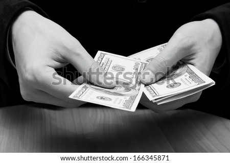 Businessman's hands counting dollars  - stock photo