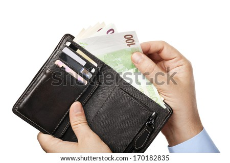Businessman's hands holding black wallet full of money - various Euros (Eur) banknotes, isolated over white background - stock photo