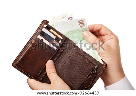 Businessman's hands holding brown leather wallet full of money - various Euros (Eur) banknotes, isolated over white background