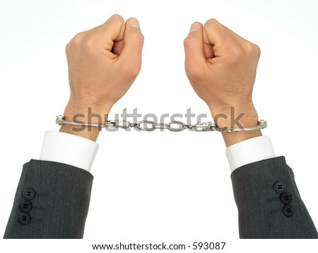Businessman's Hands In Handcuffs - stock photo