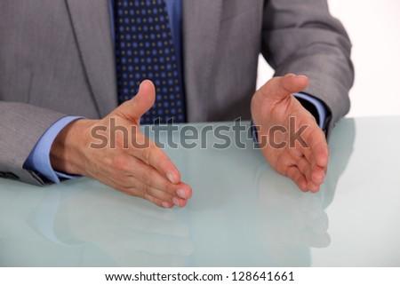 Businessman's hands on a desk - stock photo