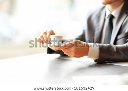 Businessman's hands working at a table, coffee - stock photo