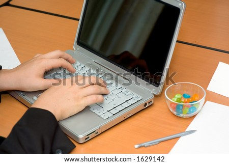 Businessman's hands working on laptop, casual work enviroment - stock photo