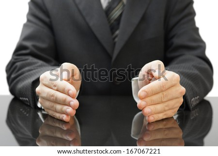businessman's protecting hands - stock photo