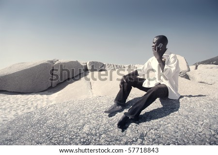 businessman's sitting on the beach - stock photo