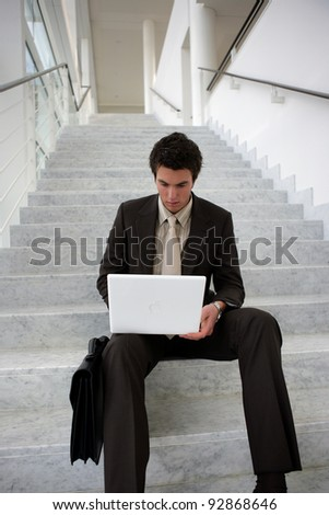 Businessman sat on the stairs