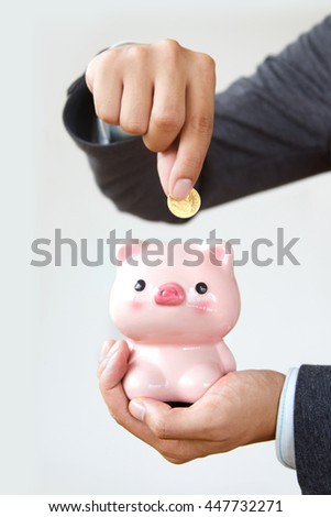 Businessman saving money in piggy bank to growth business