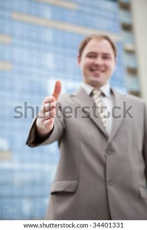 Businessman saying welcome - handshake - stock photo