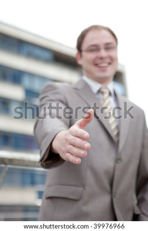 Businessman saying welcome - handshake (outdoor the office) - stock photo