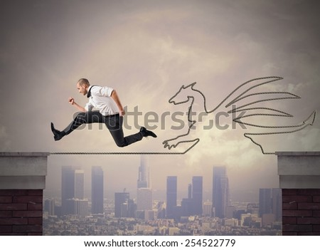Businessman scared and coward runs off quickly - stock photo