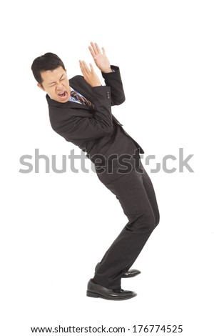 businessman scared  expression and bend down