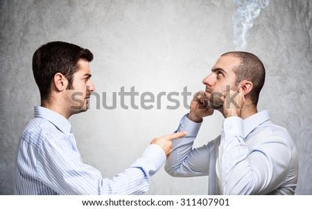 Businessman scolding a colleague - stock photo