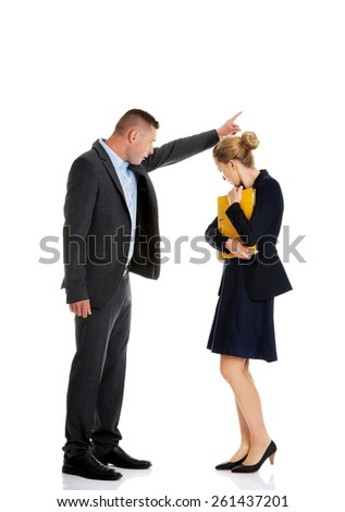 Businessman screaming at a colleague from a company - stock photo