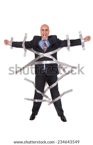 Businessman screaming, glued to the wall with duct tape - stock photo