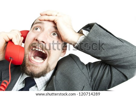Businessman  screaming into a phone - stock photo