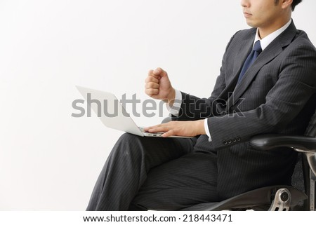 Businessman sealing his first deal and does fist pumps - stock photo