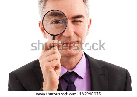 Businessman searching with magnifier new ideas