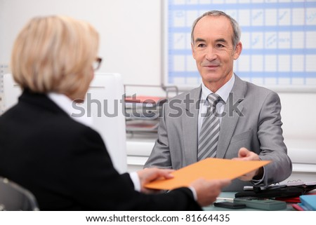 Businessman seeing a client - stock photo