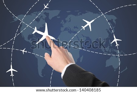 businessman select a plane for the transportation route - stock photo