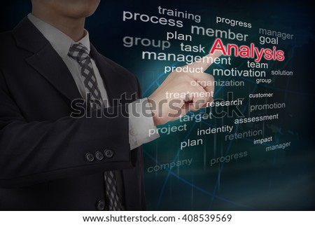 Businessman select analysis word on touch screen interface. Business concept.