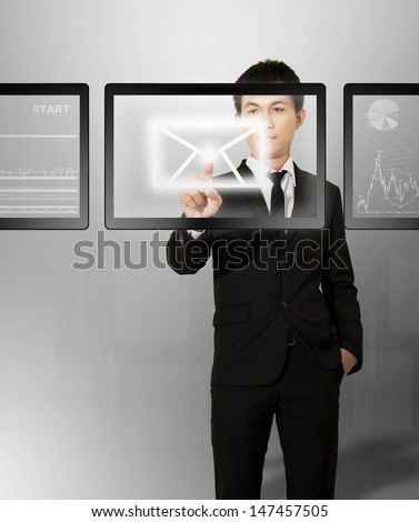 Businessman select email from digital screen in future on air - stock photo