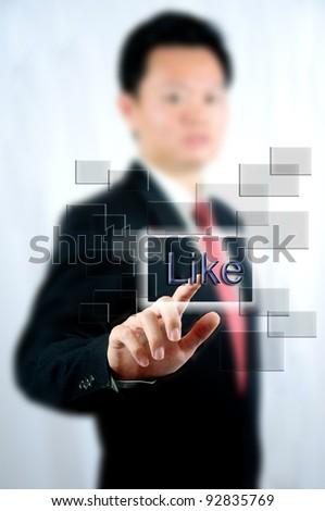 "Businessman select ""Like"" with touch screen window"