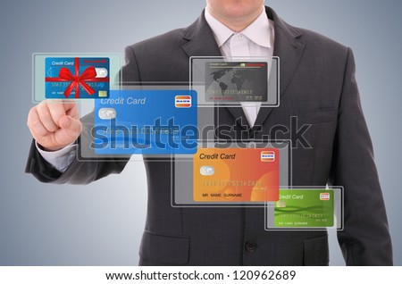 businessman selecting a credit card - stock photo