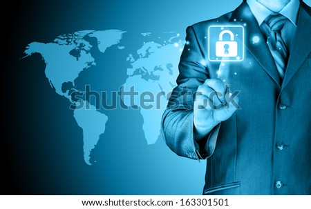 Businessman selecting a white padlock with world map on the background - stock photo