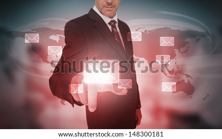Businessman selecting futuristic email interface on world map background - stock photo