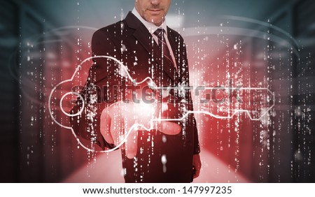Businessman selecting futuristic key graphic in data center - stock photo