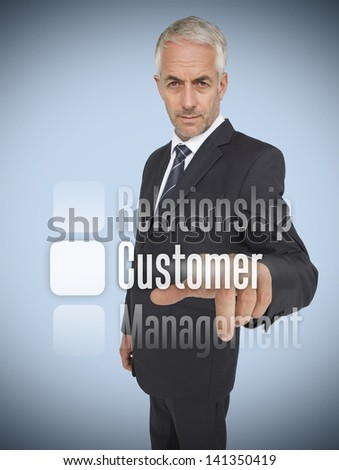 Businessman selecting the word customer on futuristic interface - stock photo