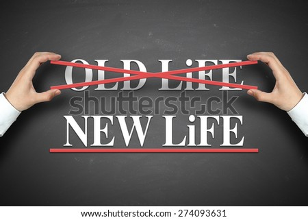 Businessman selects the New life concept on the blackboard. - stock photo
