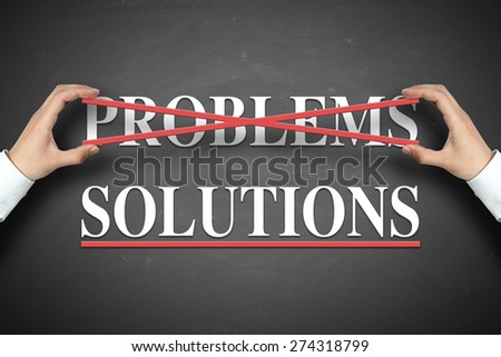 Businessman selects the solutions concept on the blackboard. - stock photo