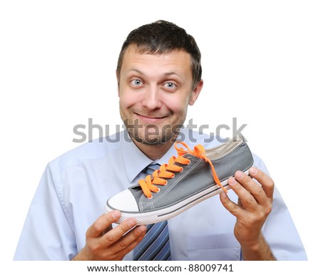 Businessman seller with shoe in hand isolated on white background - stock photo