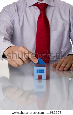 businessman selling a house (selective and soft focus) - stock photo
